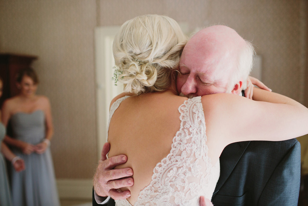 051-father-of-the-bride-hugging-his-daughter-before-wedding-ceremony-at-the-stables-binda