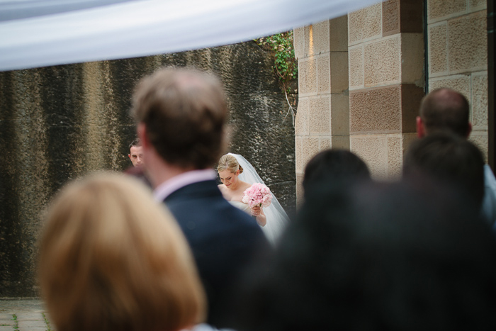 bride-walks-down-the-aisle-to-groom