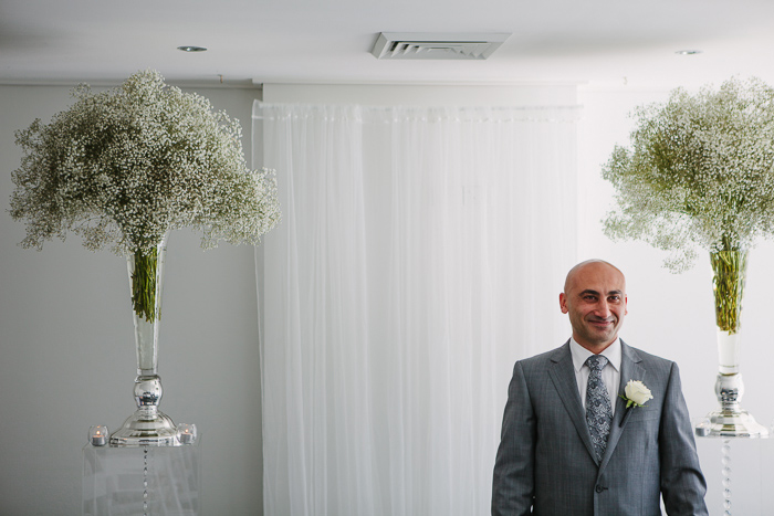 groom-waiting-for-his-bride-during-ceremony