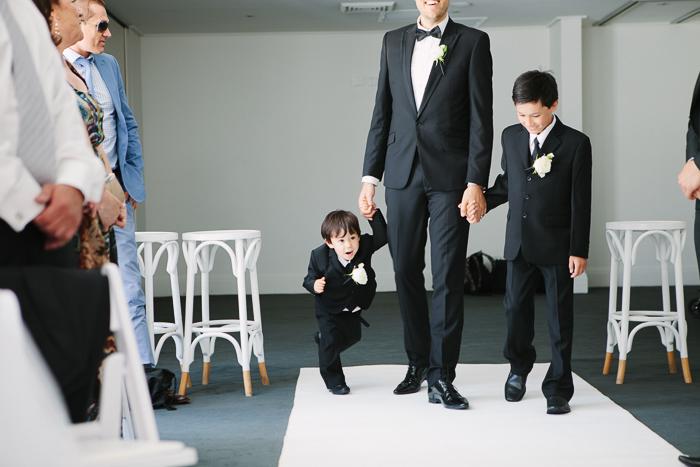 page-boy-and-bridesmaid-walking-down-the-aisle
