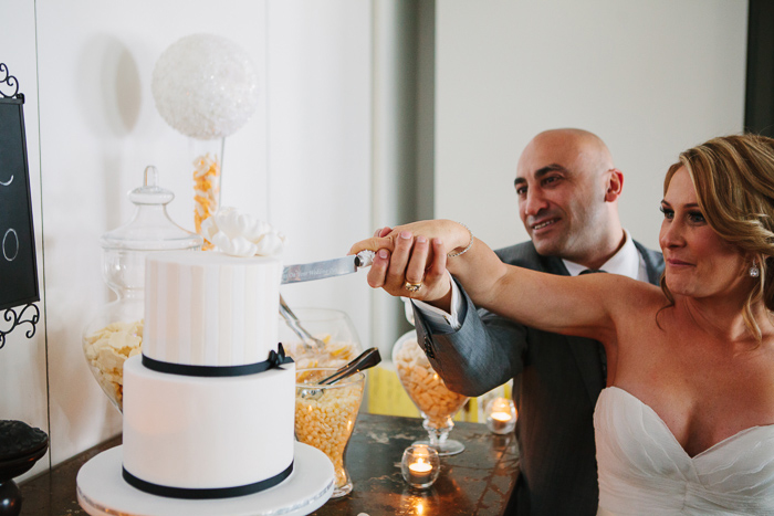 cutting-the-cake-at-wedding-reception
