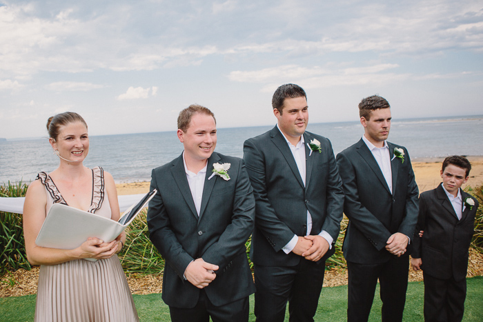 groom-and-groomsmen-wait-for-bride