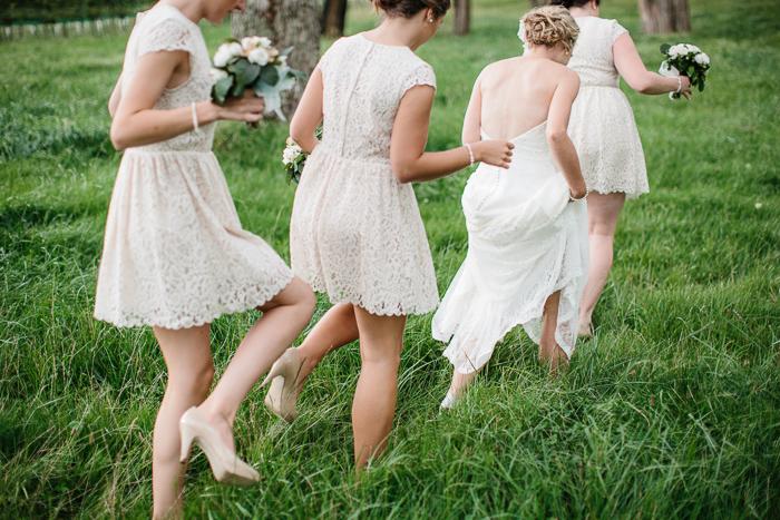 Bride walking through the Grass