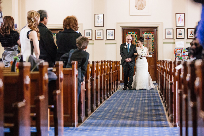 bride-walking-down-the-aisle-in-catholic-church