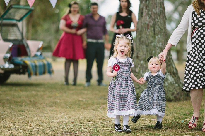rustic-flowergirls-down-the-aisle