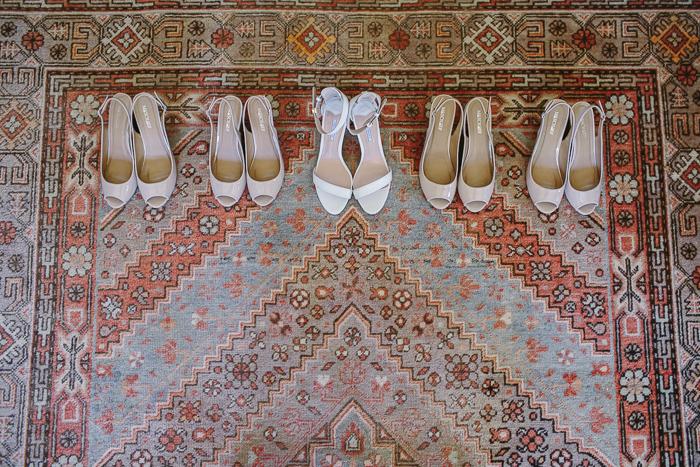 bridal shoes on vintage carpet in cottage