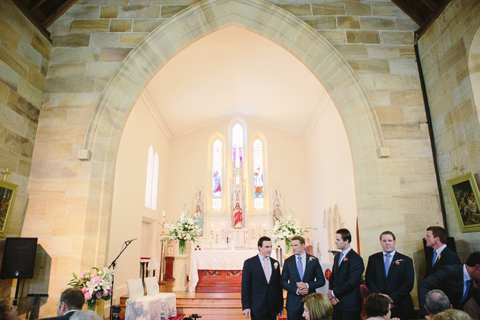 Groom waits for bride at Berrima Catholic Church