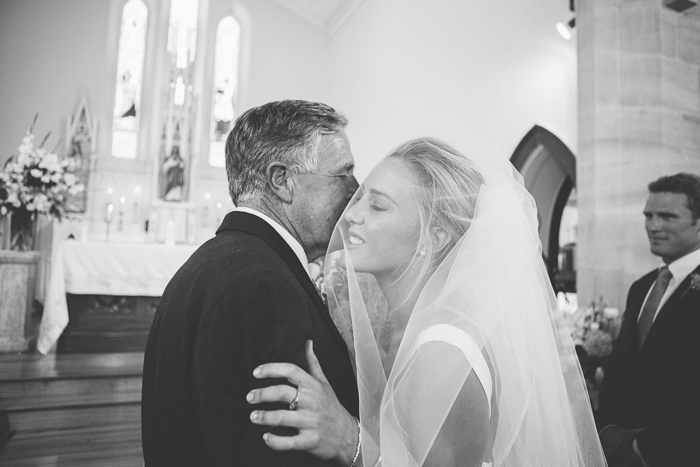 bride embraces her father at St Francis Xavier Church