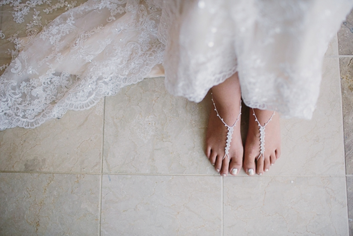 Bride wearing foot ornaments for beach wedding