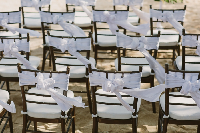 Beach Wedding in Fiji with chair sashes blowing in the breeze