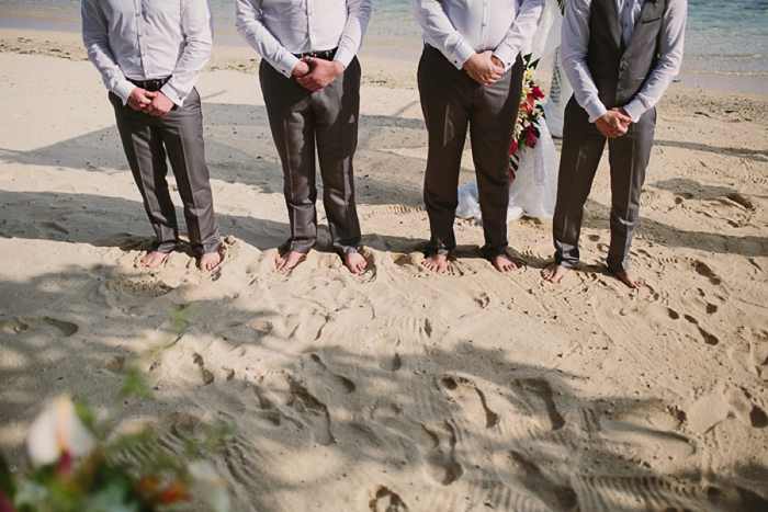 Barefoot groom on beach wedding