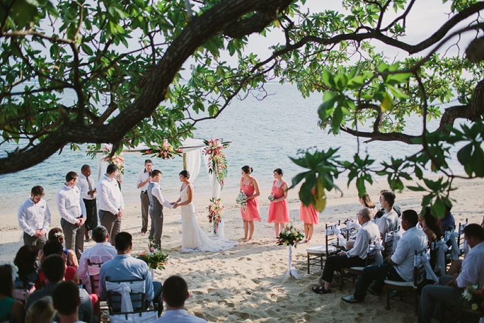 Fiji wedding ceremony on the beach under a large tree