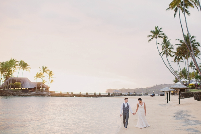 Bride & Groom walking during Golden Hour in Fiji