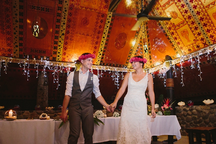 Bride & Groom crowned with traditional flowers