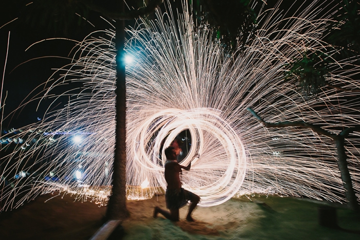 Fire twirling and Sparks during Fijian performance