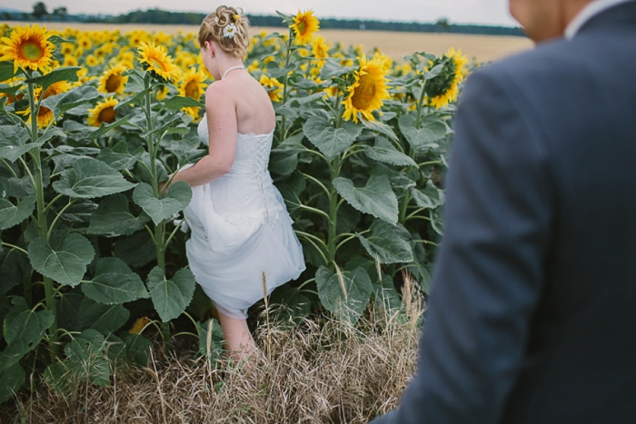 bride-and-groom-in-sunflower-field