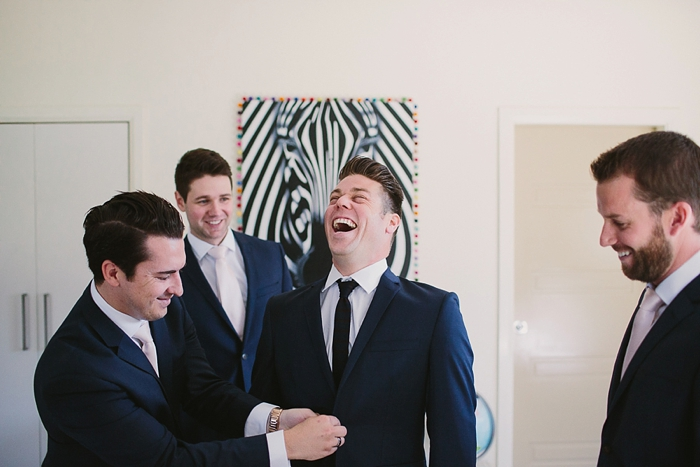 groomsmen preparations wedding photographer