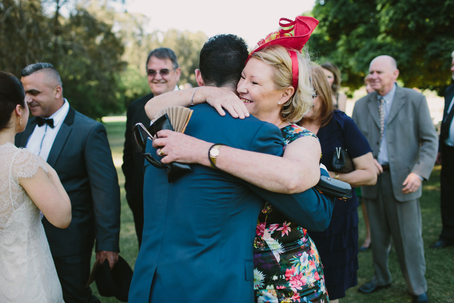 Mother of the groom hugs her son after wedding ceremony