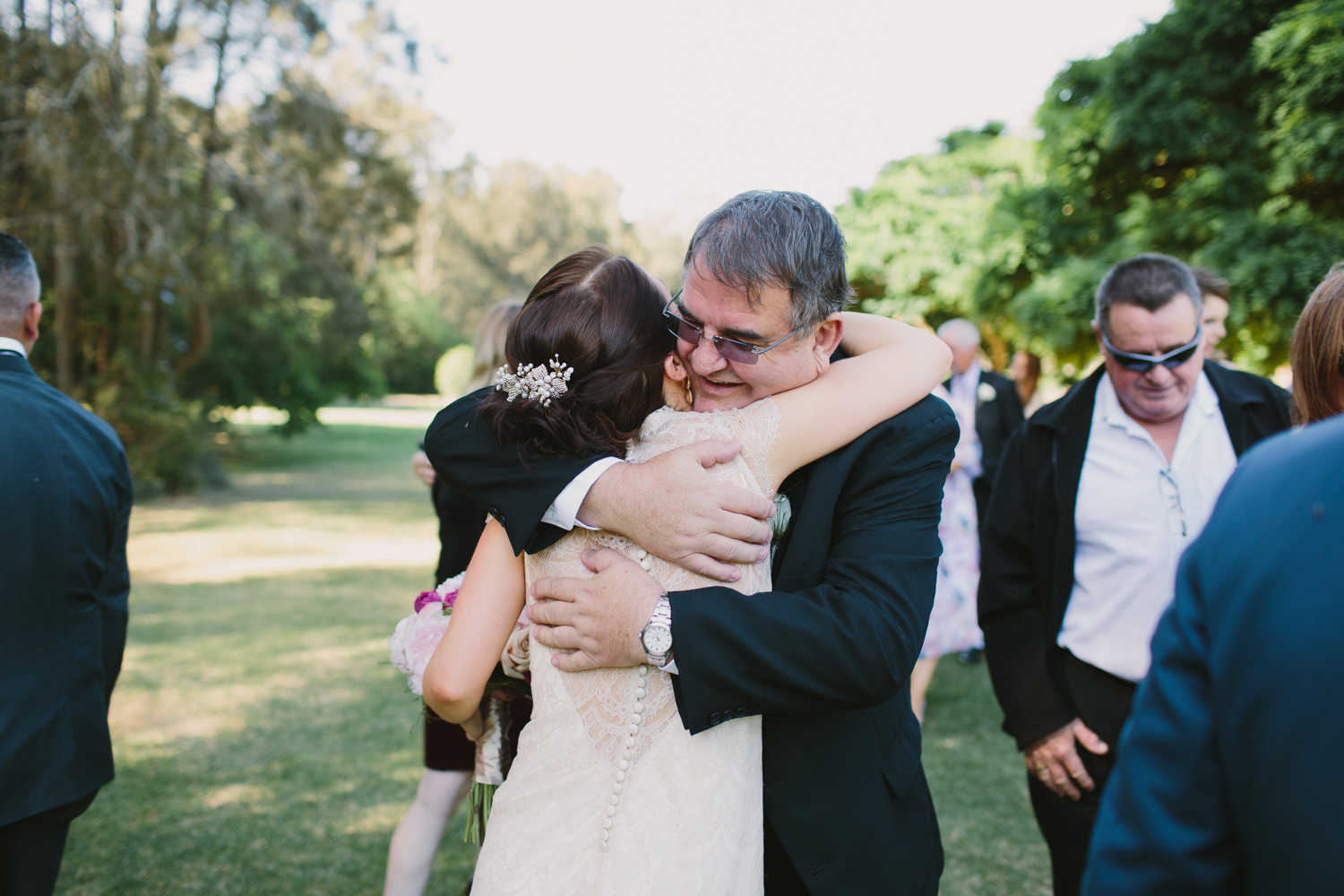 Father of the Groom hugs his new daughter at Hunter Valley wedding