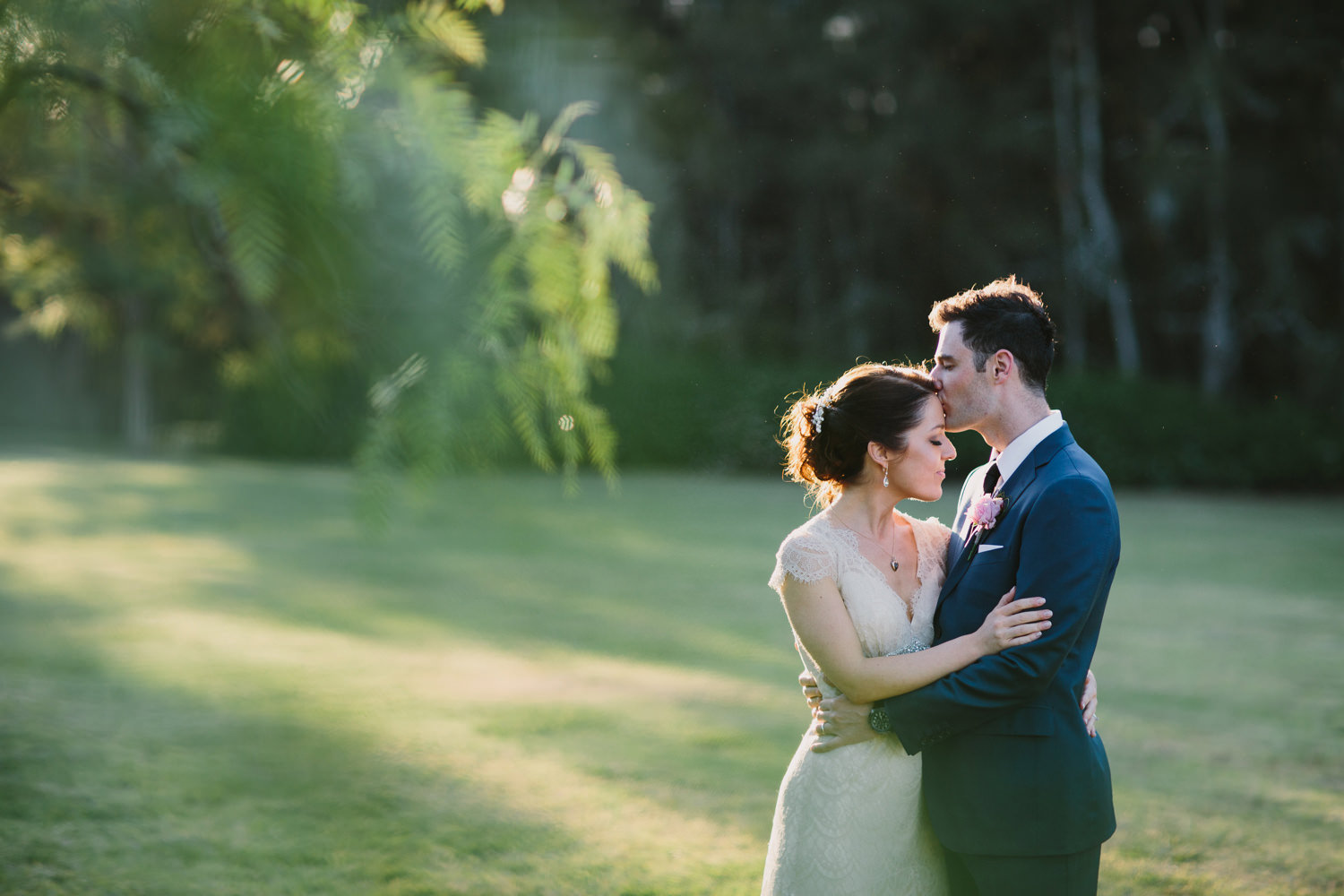 Bride and groom kiss in the sun after Hunter Valley wedding
