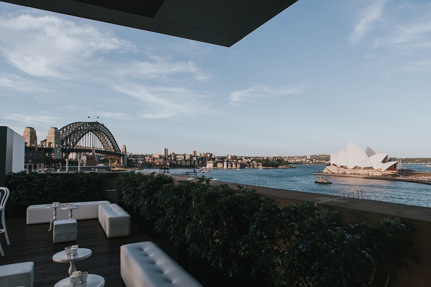 view of sydney harbour bridge from the terrace at the mca