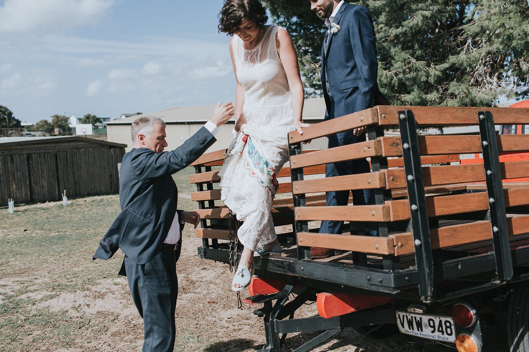 father of the bride helping daughter