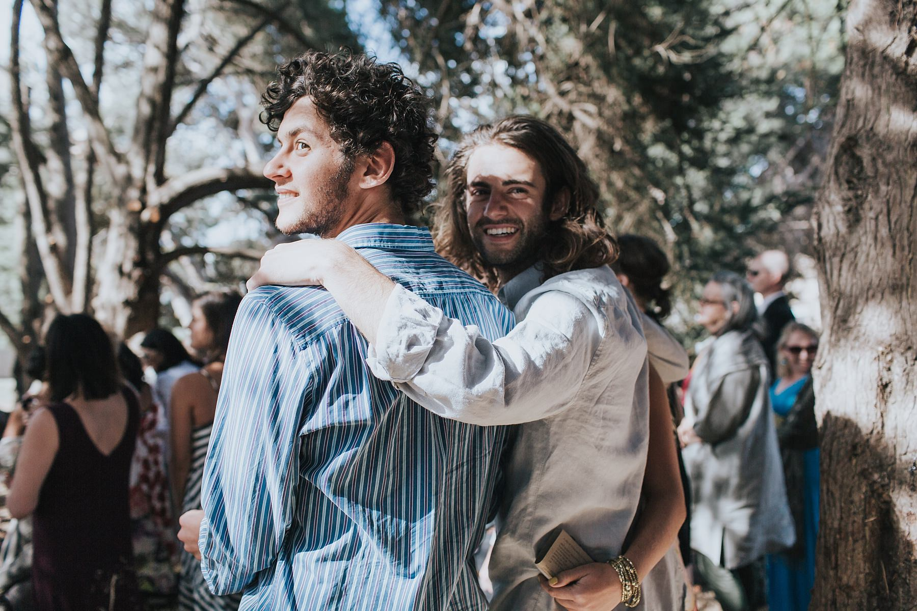 brides brothers watch their sister walk down the aisle