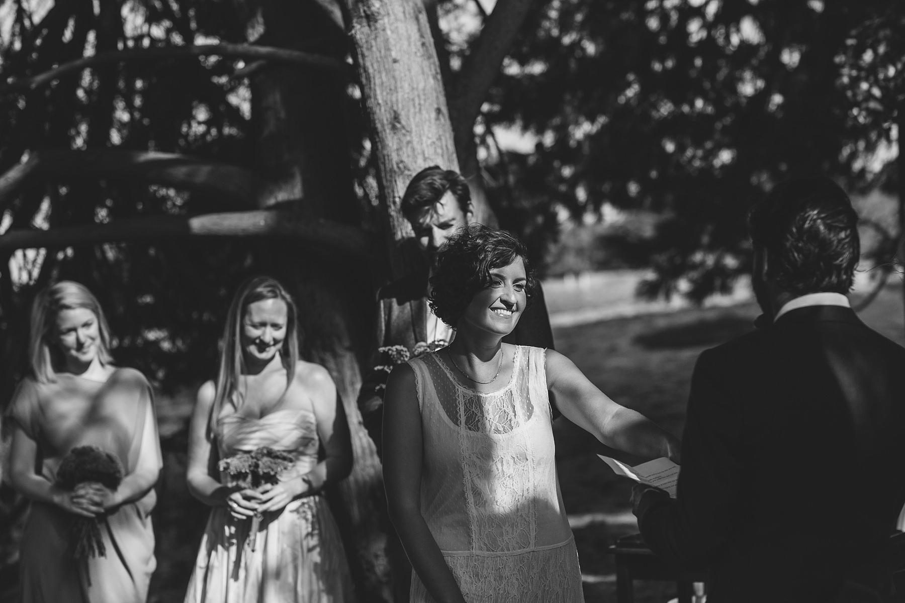 bride holds onto her groom during wedding ceremony