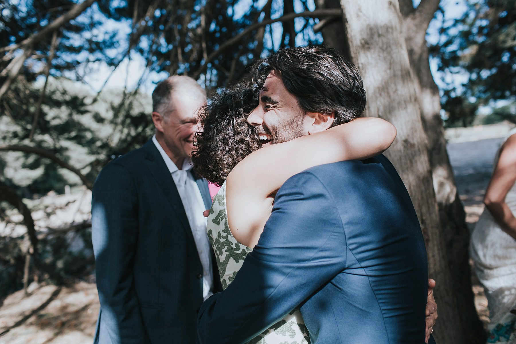 excited hugs and tears at wedding ceremony