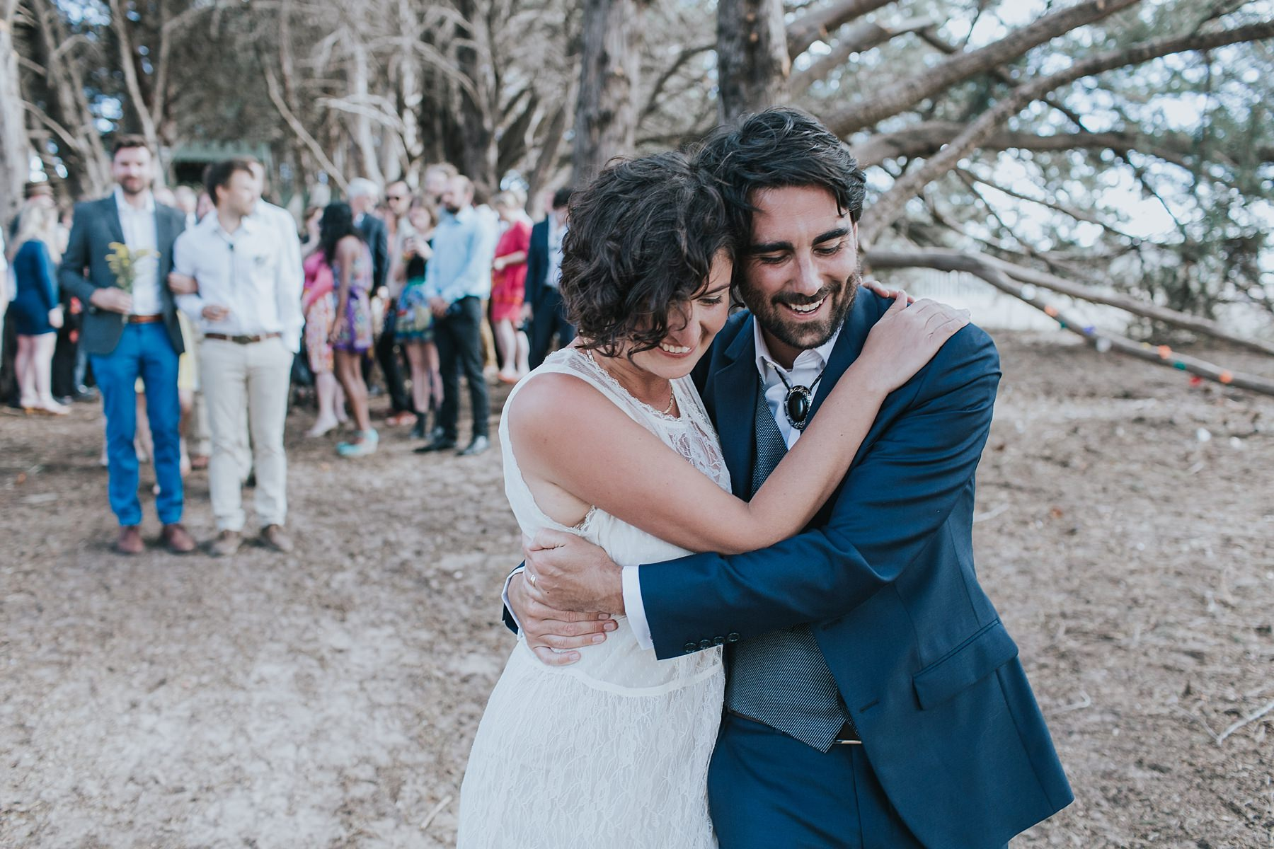 bride and groom in a tight embrace
