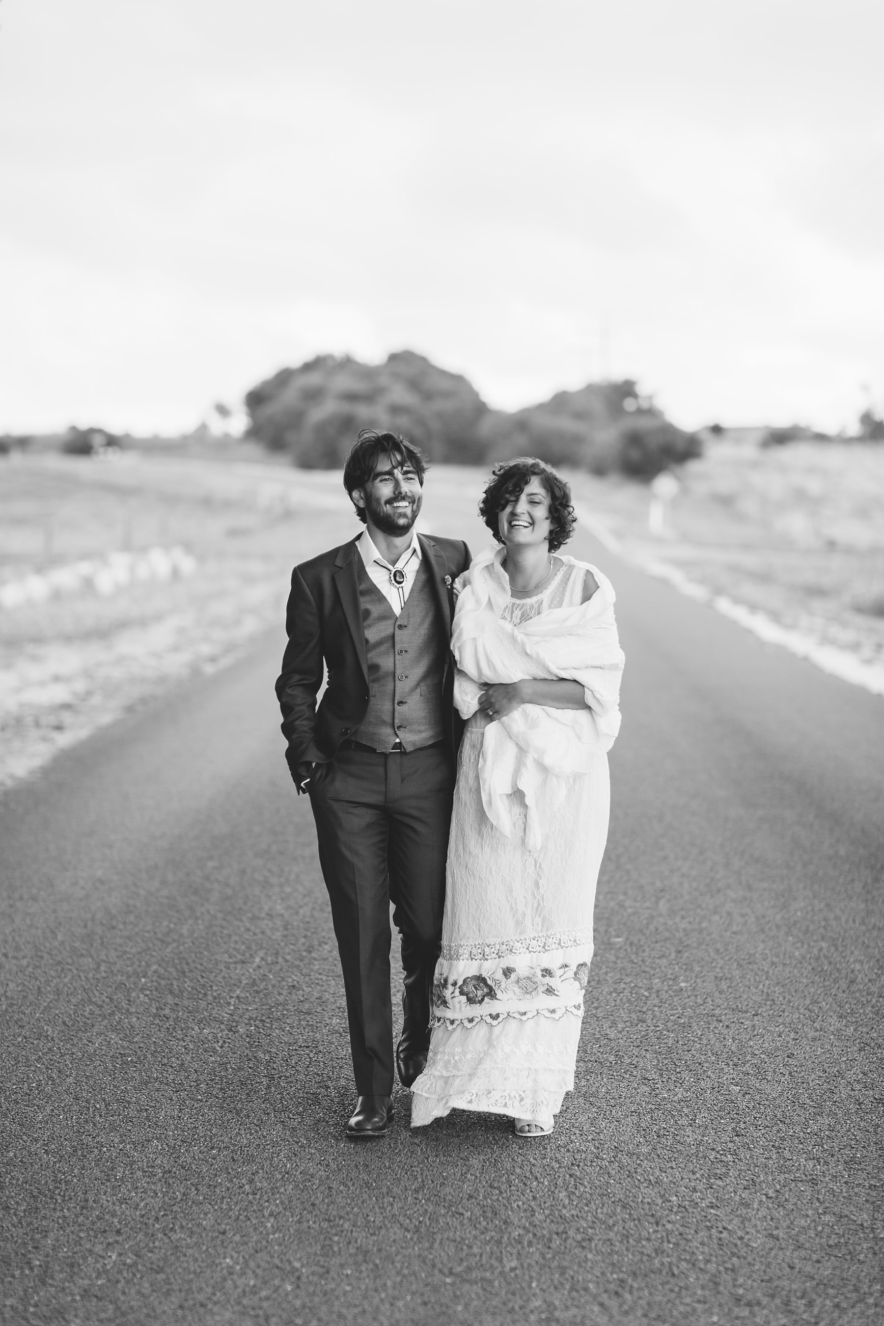 bride & groom walking down the road together