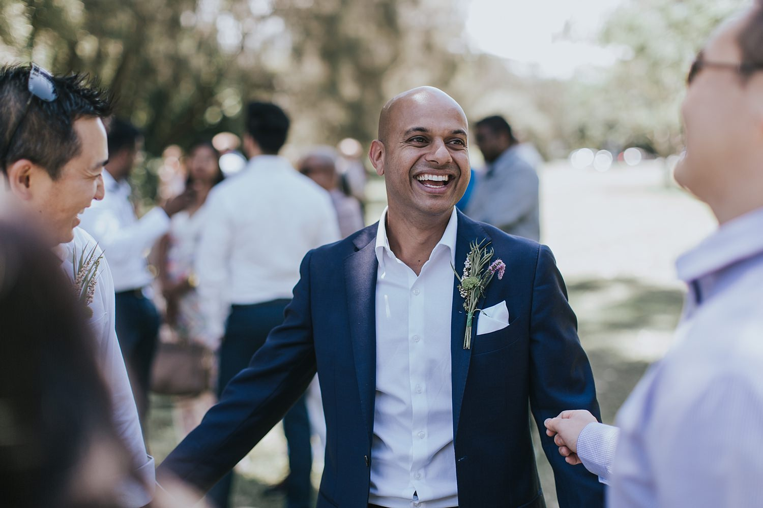 groom happily smiling for his wedding day