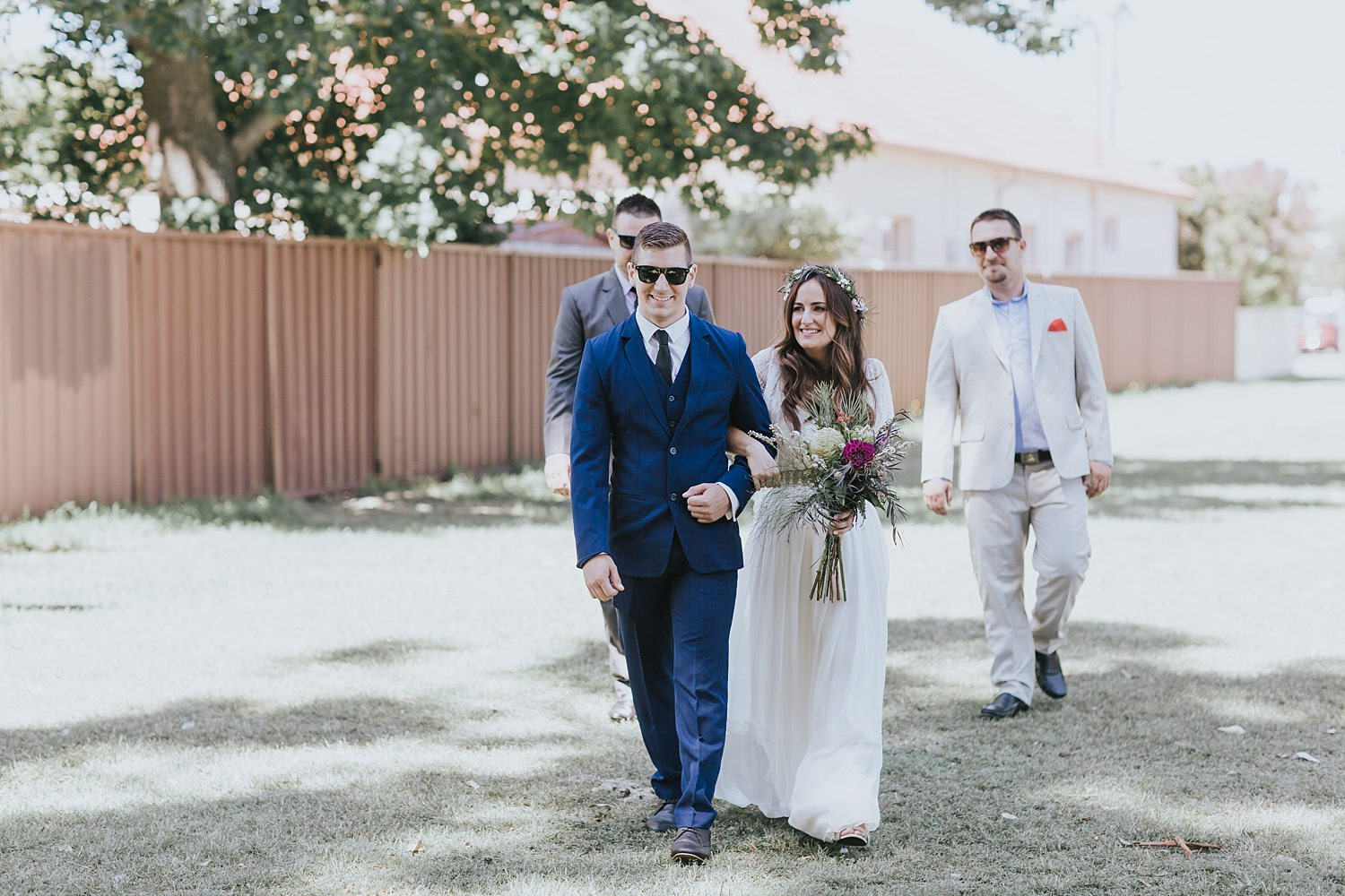 bride being walked down the aisle by her brother