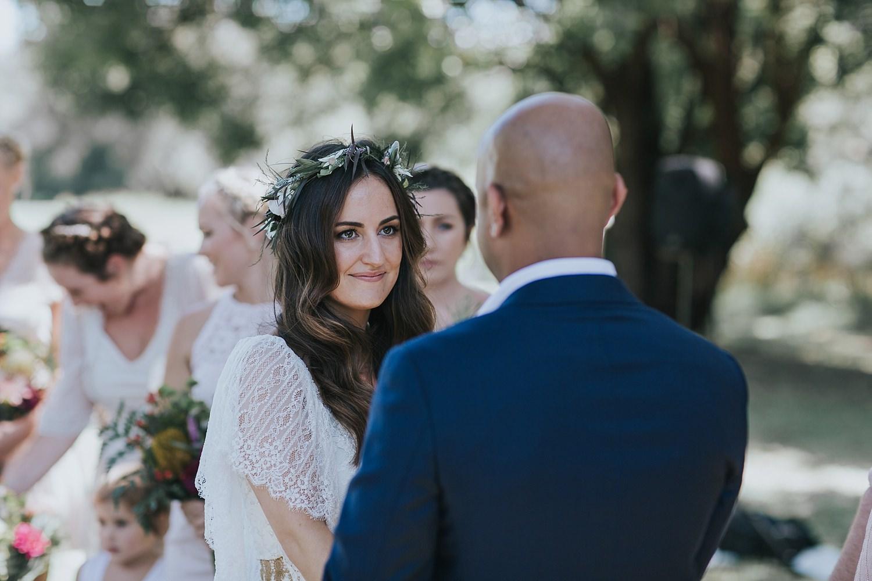 beautiful bride eyes her man