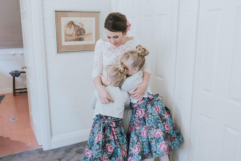 bride hugs her nieces before the wedding ceremony