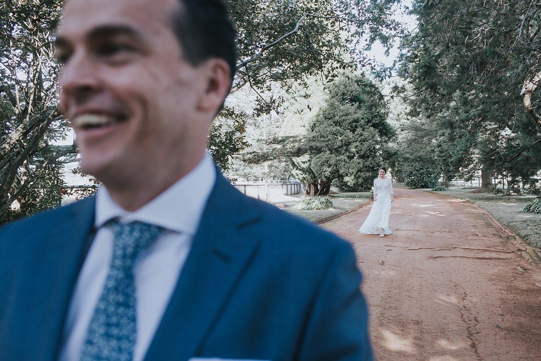 bride walking towards her groom for first look at bendooley estate berrima