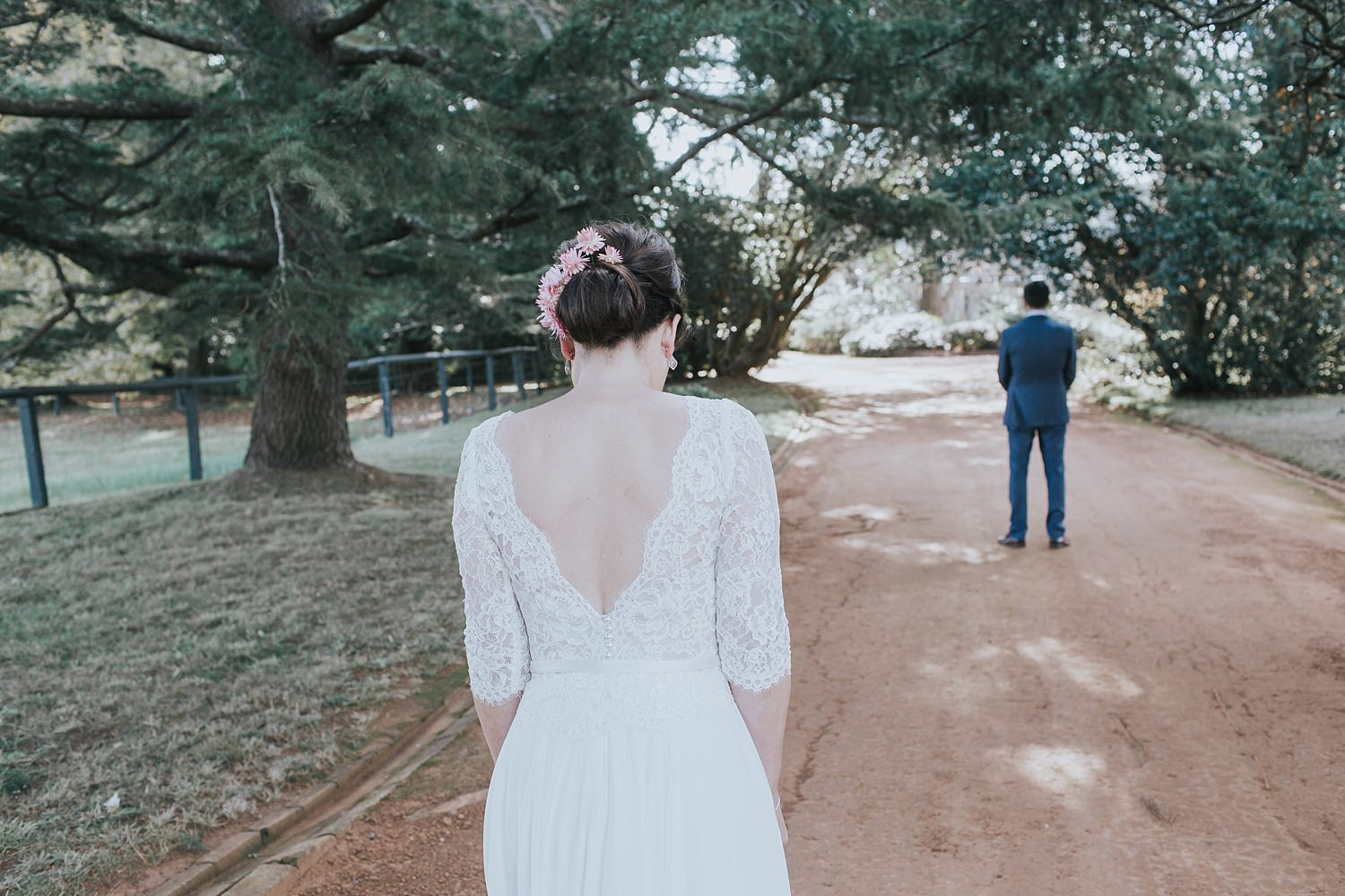 bride approaches her groom on bendooley estate driveway