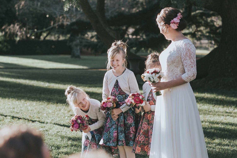flowergirls laughing during bendooley estate wedding ceremony