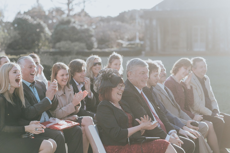 guests cheer during bendooley estate wedding ceremony