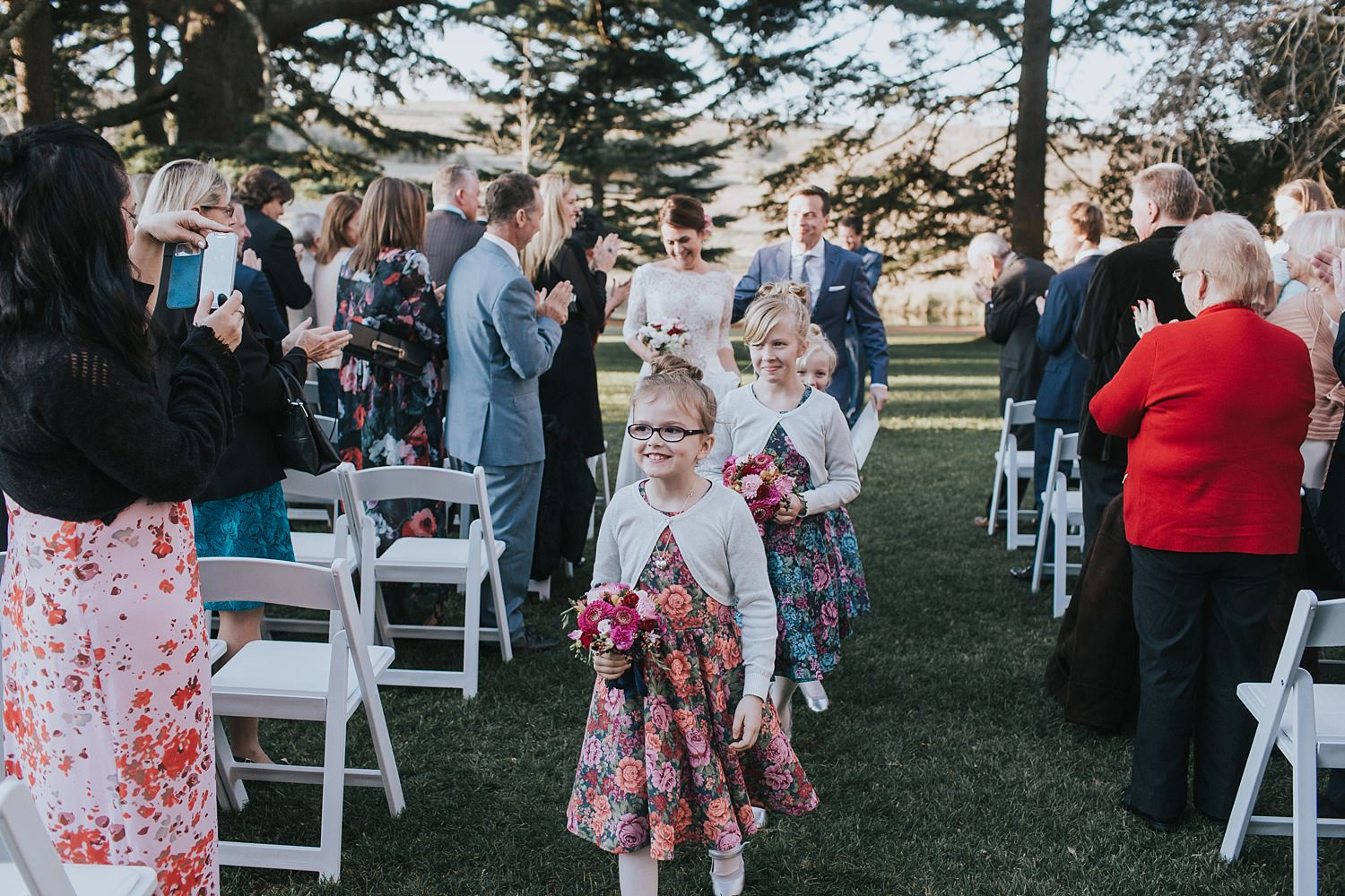 flowergirls lead the couple down the aisle