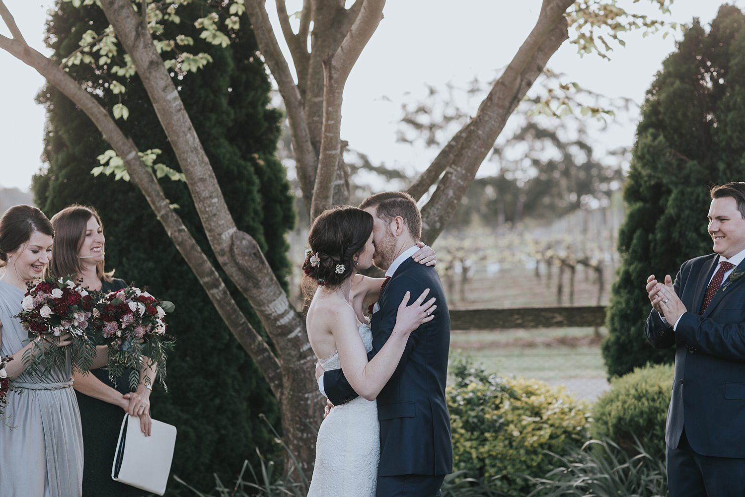 husband and wife kiss during ceremony in bowral
