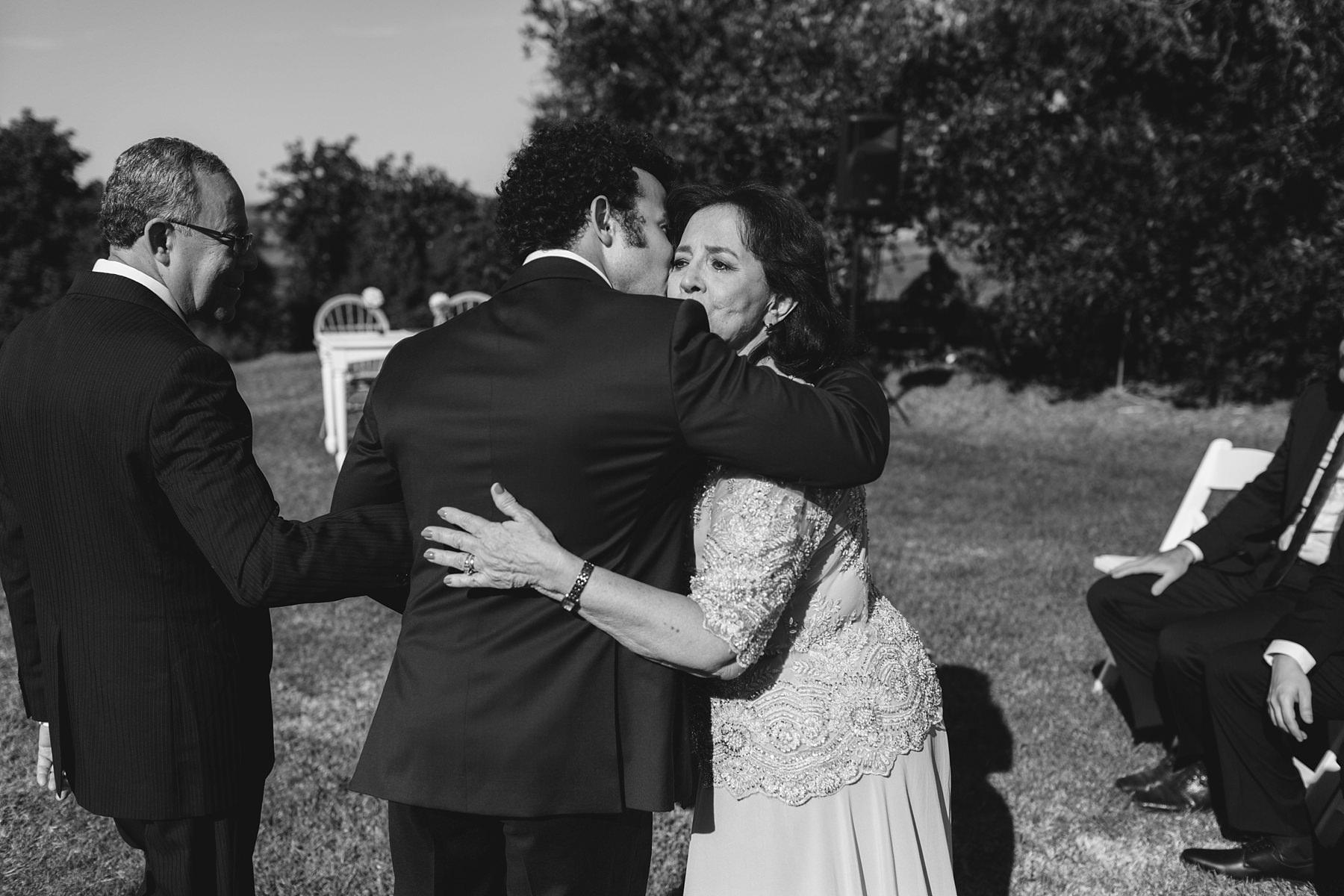 mother of the groom hugs her son