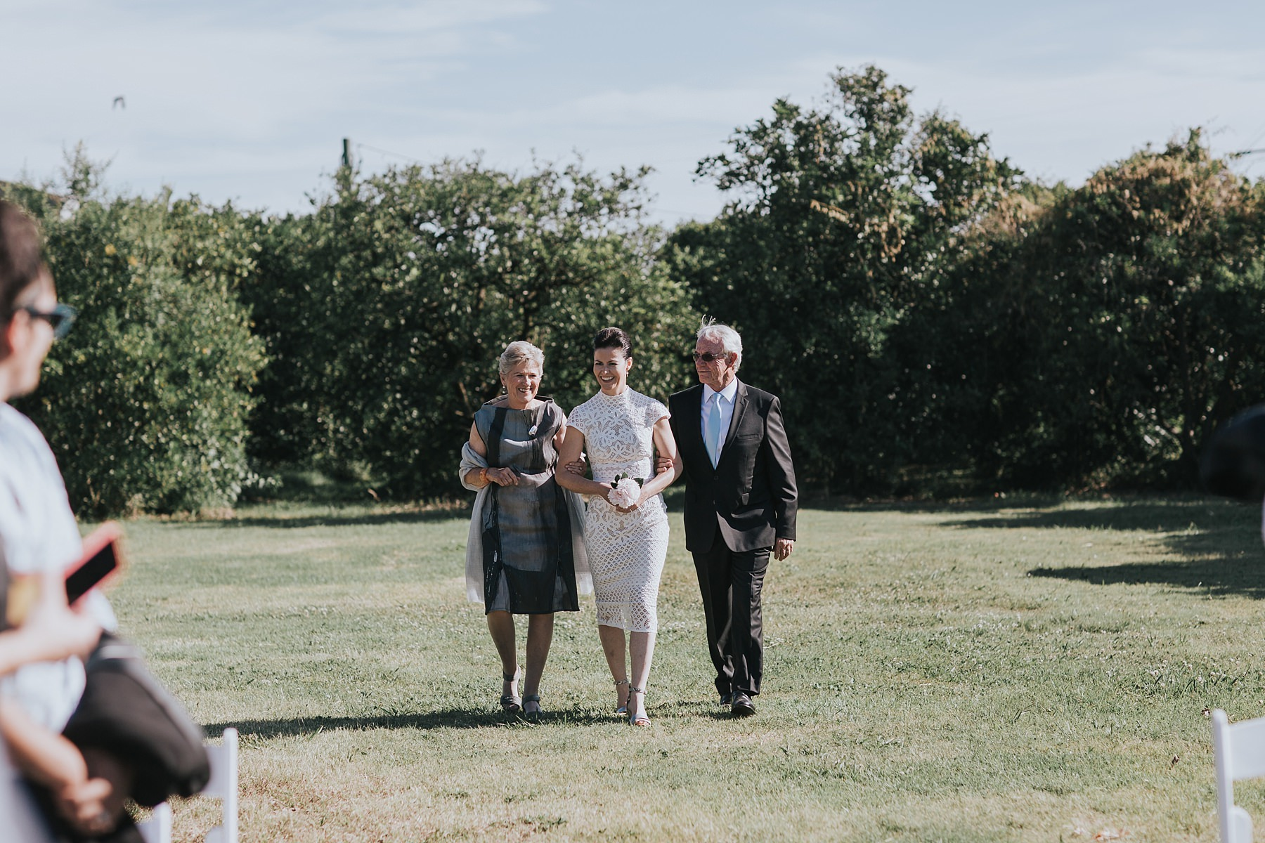 bride walked down the aisle by her parents at cornwallis house