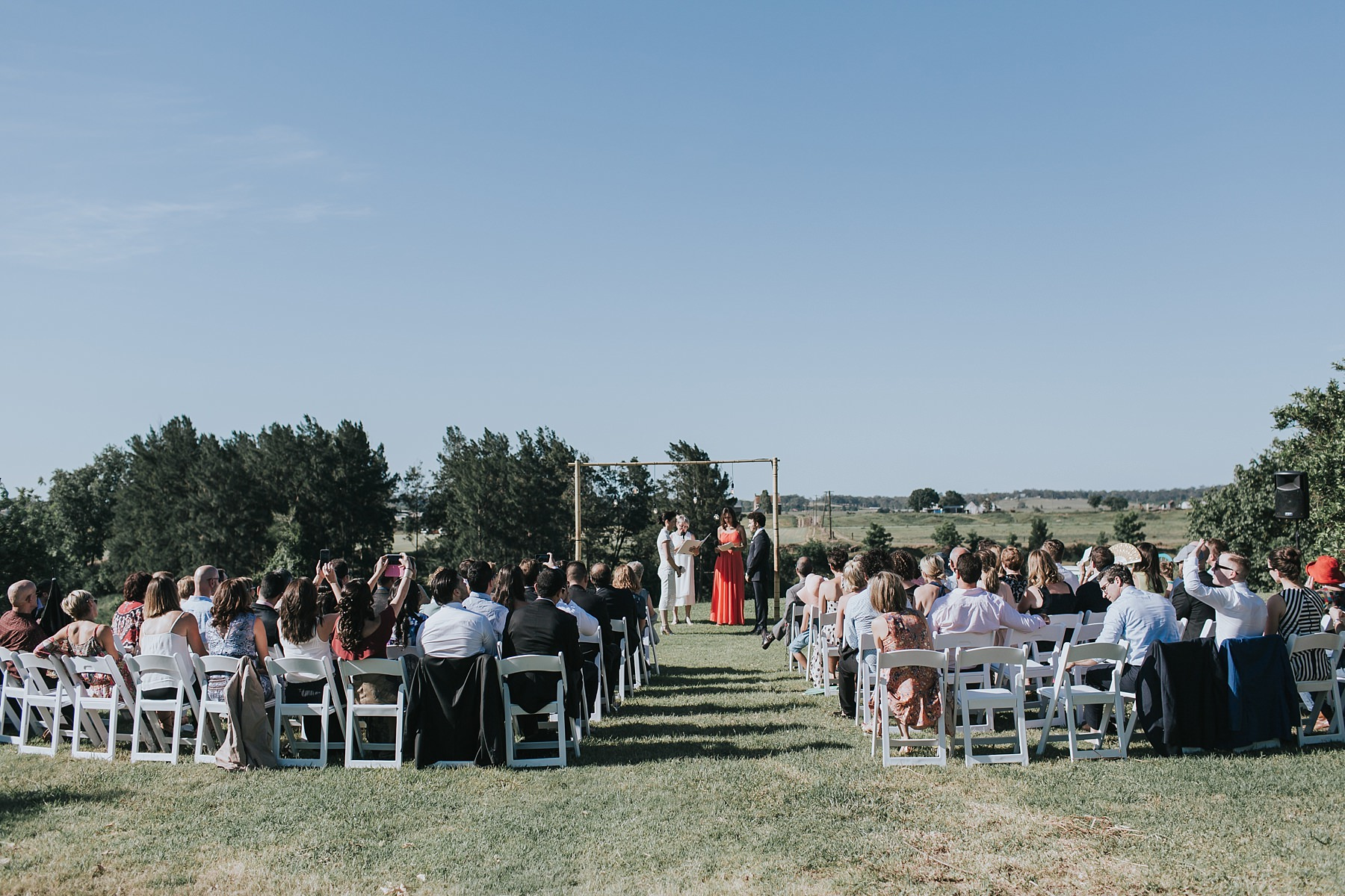 outdoor wedding ceremony in the sun at cornwallis house
