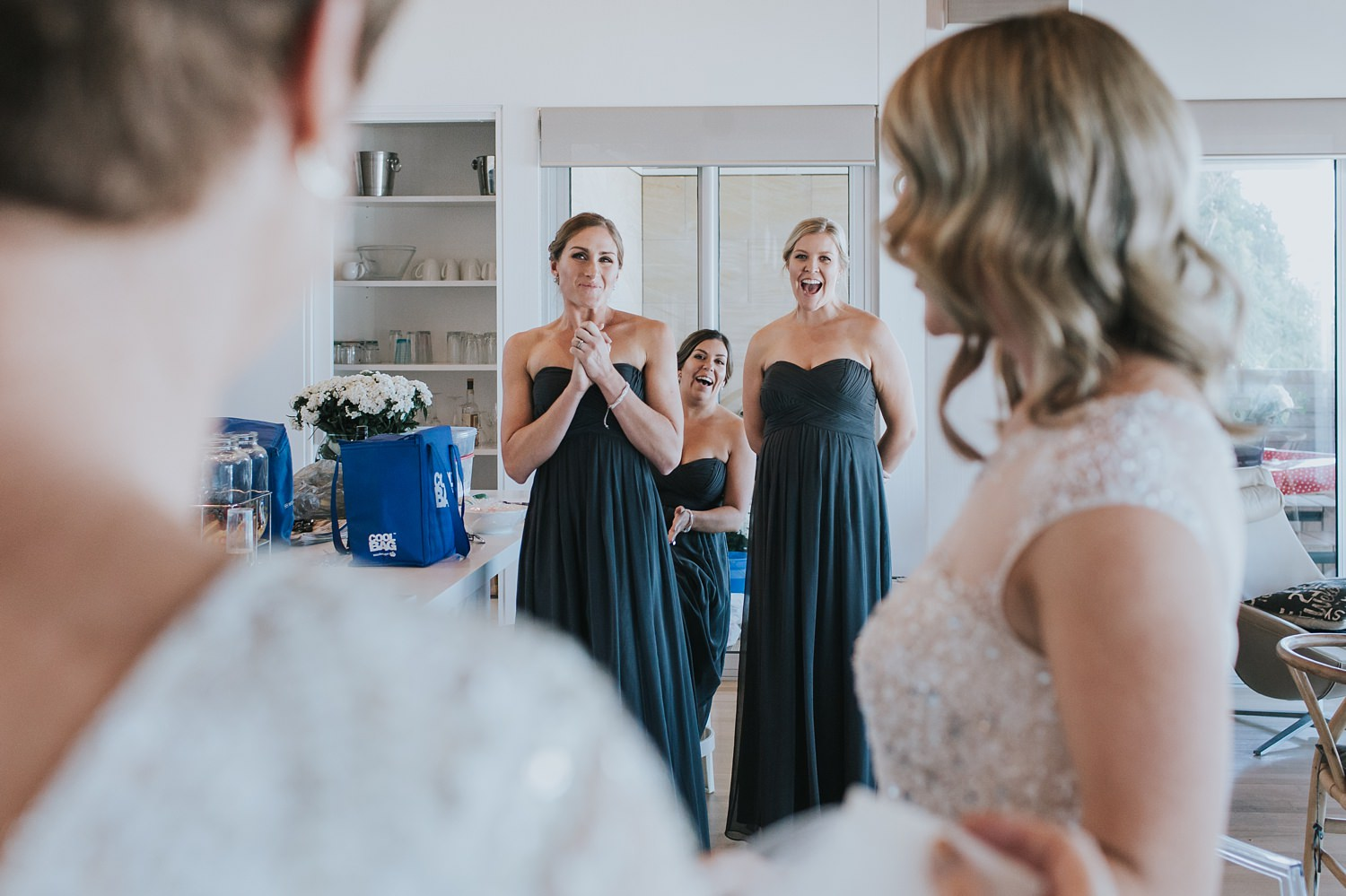 bridesmaids excited to see bride