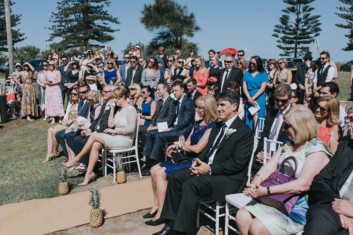 guests at palm beach wedding enjoying ceremony