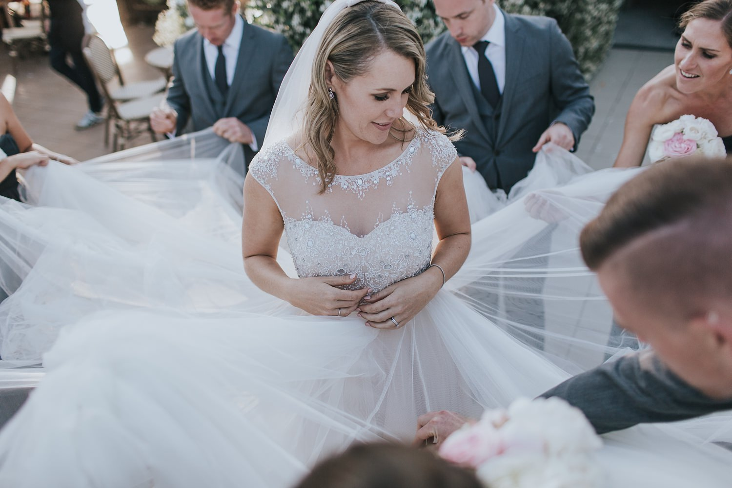 help from the bridal party to clean her dress