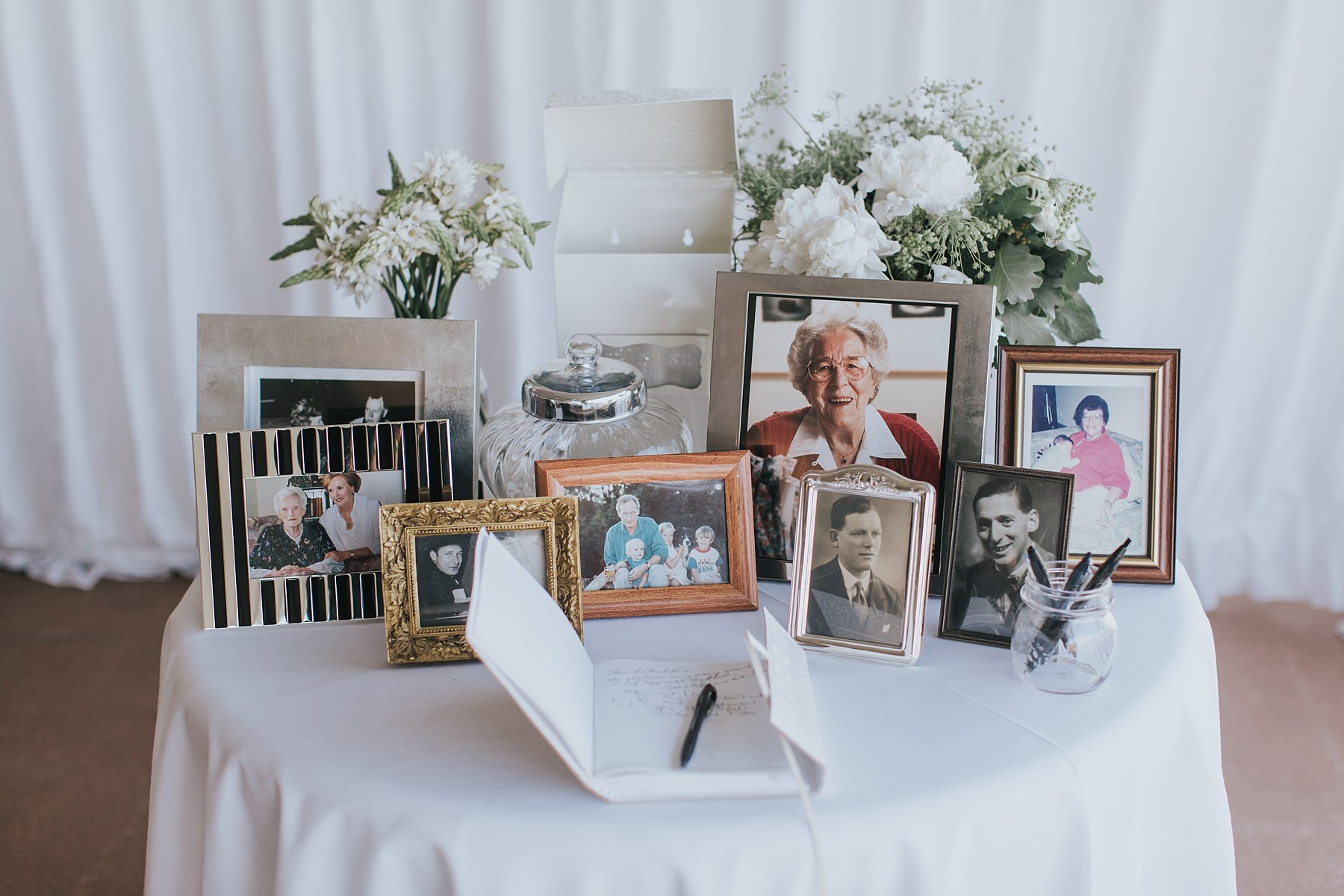 grandparents framed photos at wedding reception