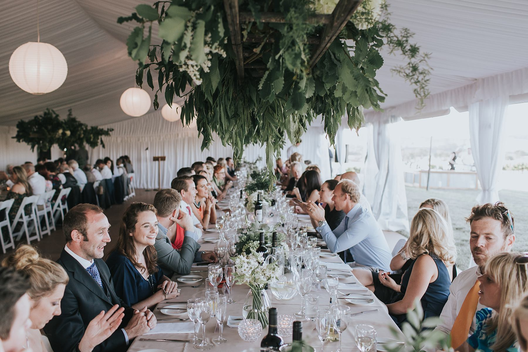 guests seated in marquee for wedding reception