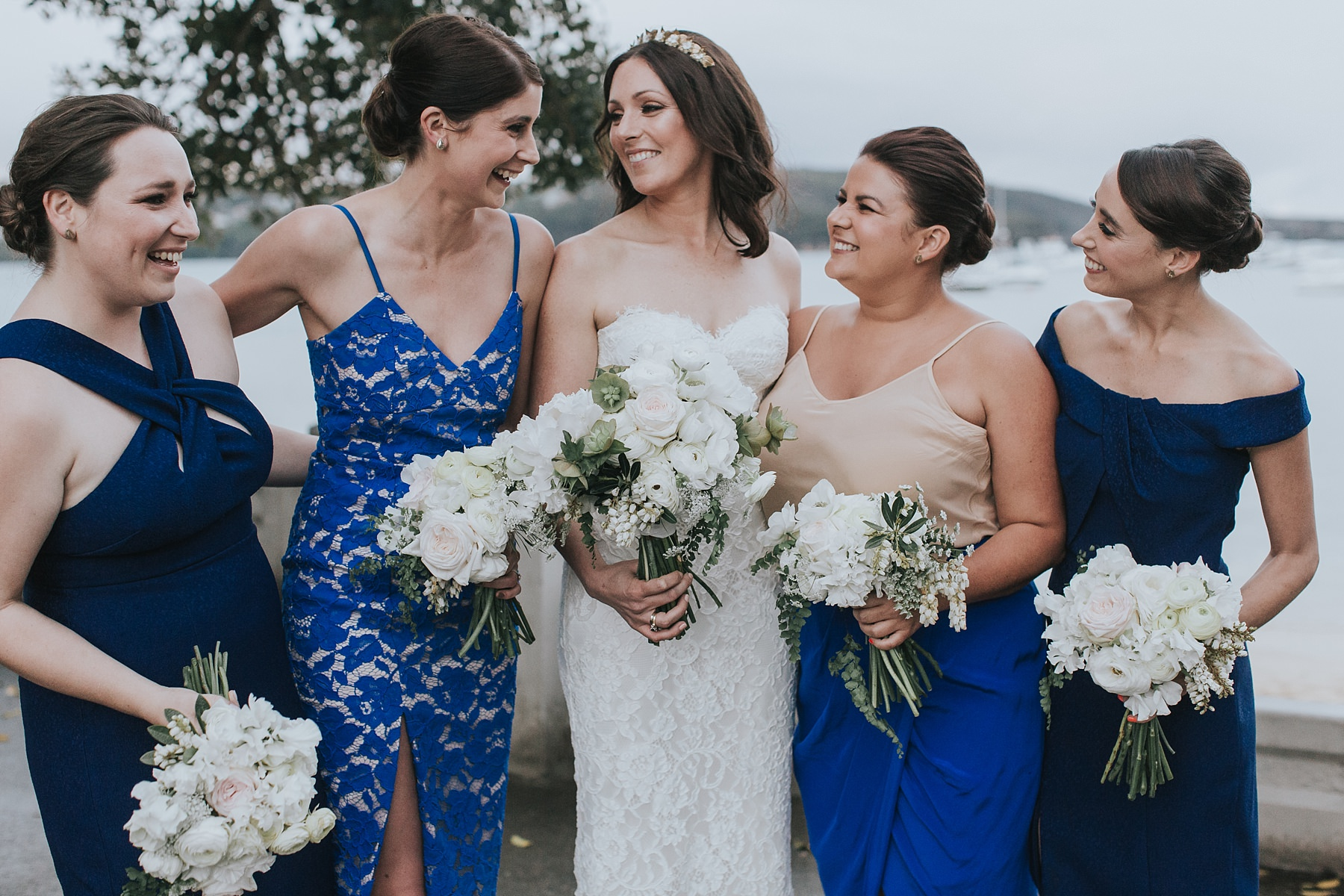 bridesmaids laughing at balmoral beach